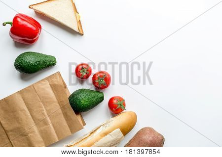 natural food set with fresh vegetables and baguette on white table background top view mock-up