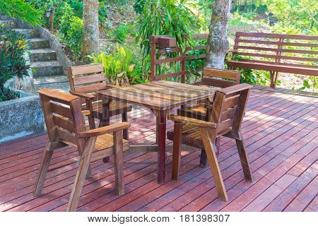 Wooden Table And Chair In Resort And Garden, Dining Set At Wooden Terrace In Restaurant.