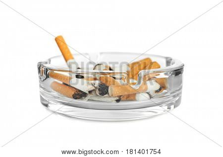 Cigarette butts in ashtray on white background