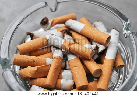 Cigarette butts in ashtray, closeup