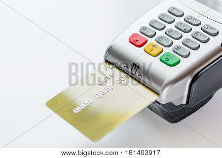 purchasing concept with credit card payment and terminal on white table background