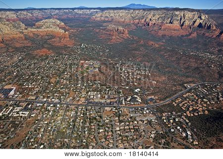 Aerial view of the red rocks and canyons of Sedona at the junction of 89a and Soldiers Pass Road poster