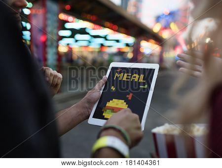 8 bit illustration of tasty burger meal on digital tablet