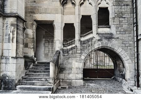 Stone stairs and cloisters in a gothic building in Troyes France