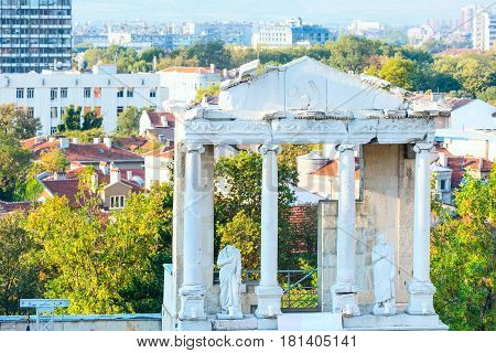 Panoramic background with statue, column and fragment of ancient roman amphitheater, Plovdiv, Bulgaria
