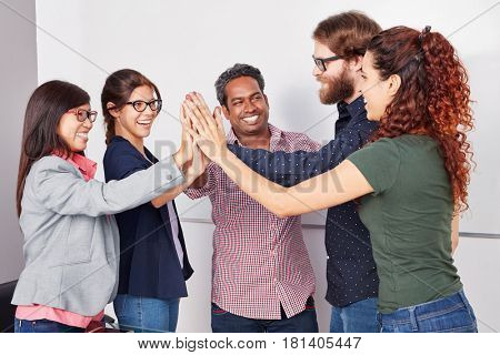 Team High Five in startup with successful creative business team