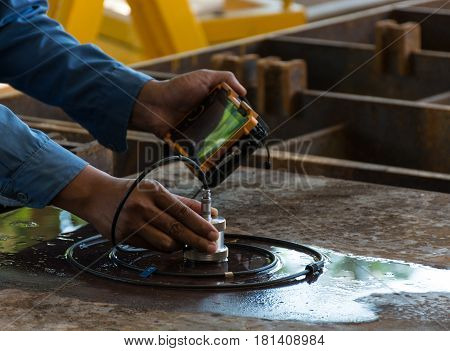 Ultrasonic test to detect imperfection or defect of steel plate in Workshop NDT Inspection.