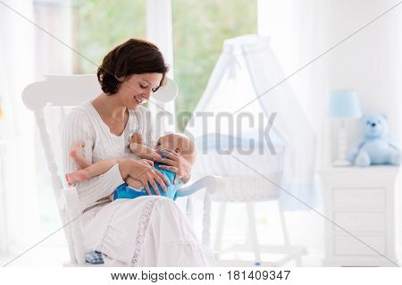 Mother And Baby In Bedroom