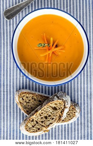 Carrot Soup Served in Bowl with Bread. Homemade Cream Carrot and Potato Pottage.