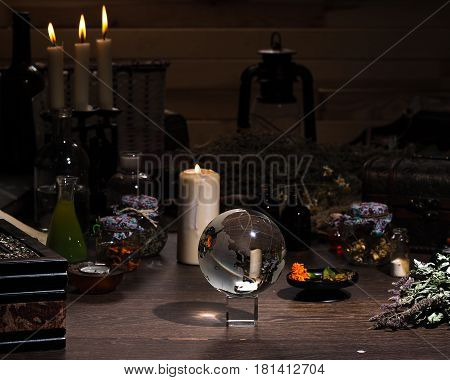Mystical still-life. Magic ball dry herbs all for magical rituals. A lot of items. Candles