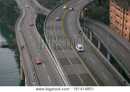 ChongqingChina Thailand - Dec 22 2015 : Cityscape Expressway cross road with traffic building and transportation beside jialing riverview from Skyscraper.