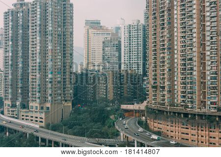 Chongqing China - Dec 22 2015: The view of foggy crowded city beside the jialing river and roads