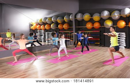 Children at physical education lesson in school gym