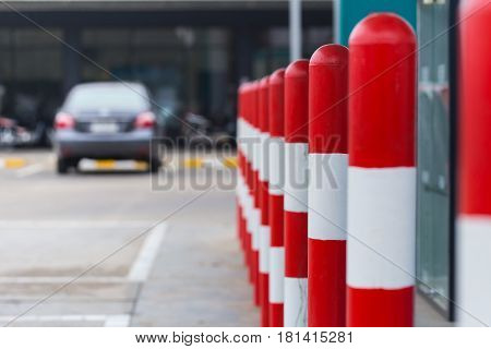 red white stripe pole car parking warning area at fuel gas station.