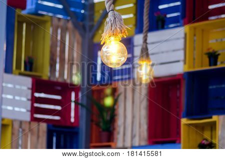 Lamp on a multicolored background of boxes