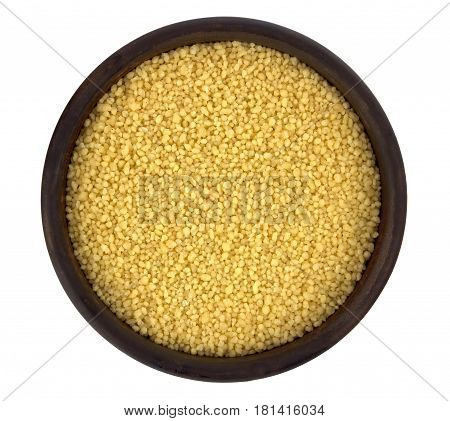 Couscous into a bowl isolated in white background