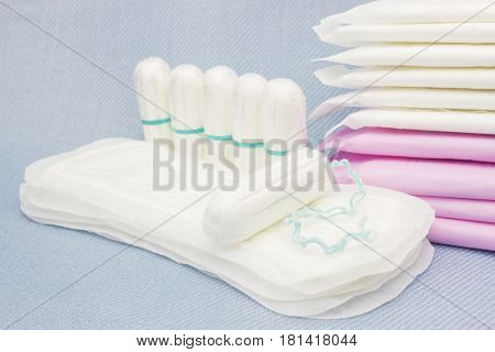 Soft tender protection for woman critical days gynecological menstruation cycle. Menstruation sanitary pads and cotton tampons for woman hygiene protection.