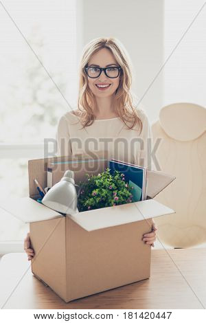 Vertical Portrait Of Happy Glad Cheerful Woman At New Office Of Her Dream Holding Carton Box Full Of