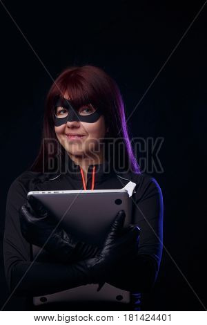 Brunette thief holds stolen laptop