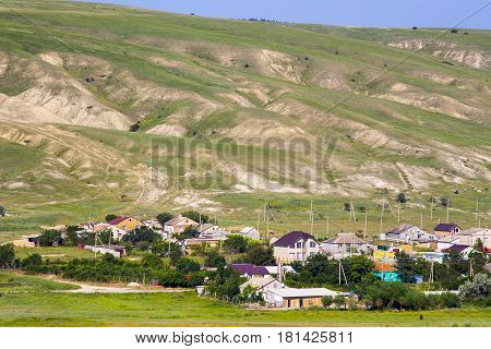 Crimean Tatar settlement on green hills background