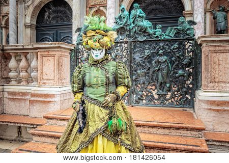 Green mask costume at carnaval, Venice, Italy.