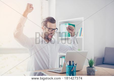 Yes! Smiling Happy Businessman In Glasses And White Shirt Raising Hands, Achieving The Goal While Lo