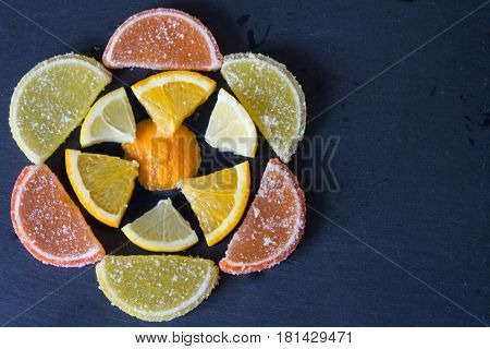 Colorful sugary marmalade like lemon and orange slices covered with sugar. Fruit jelly candies. Dolce vita. Closeup. Top view.