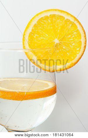 A Glass With Soda, Garnish With Orange Slices,