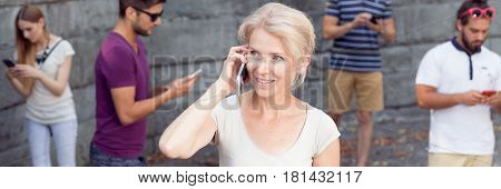 Passersby Using Their Phones