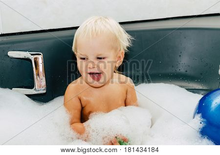 The child is bathing. The bath is full of foam. Photos in the style of 90's.