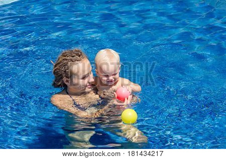 Games in the outdoor pool. Family on vacation. Spa Resort