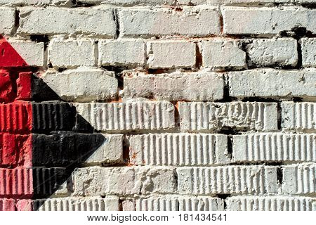 Abstract detail of brick wall with fragment of colorful graffiti. Urban Art closeup. With place for your text, for background use. Aerosol city design