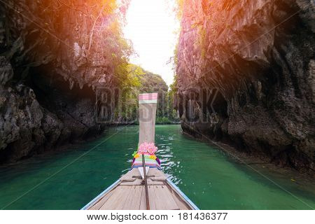 Traveler concept - long old wooden boat traveling to Hong Islands in andaman sea Krabi South of Thailand.