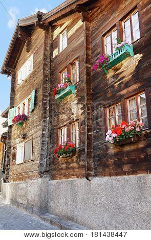 Chalet With Flowers At Balconies At Zermatt Village In Switzerland