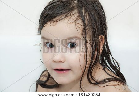Little girl is washed in a bath with foam, happiness, fun, smile, portrait, suprise
