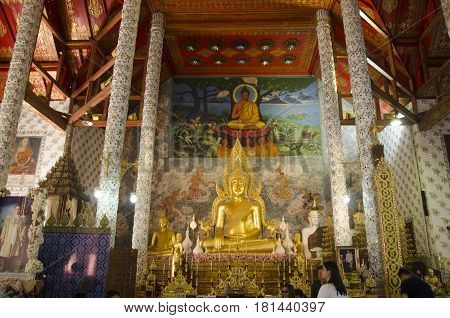 Golden Big Buddha Statue In Ubosot For People Praying And Respect Of Wat Phra That Cho Hae Temple At