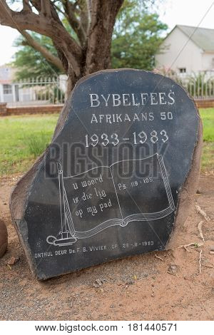 ABERDEEN SOUTH AFRICA - MARCH 23 2017: A memorial stone at the Dutch Reformed Church in Aberdeen commemorating 50 years since the first translation of the Bible into Afrikaans