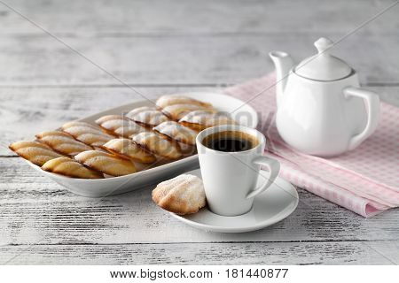 Homemade Vanilla Cookies Madeleine With A Cup Of Coffee On A Wooden Background. Holidays Food.