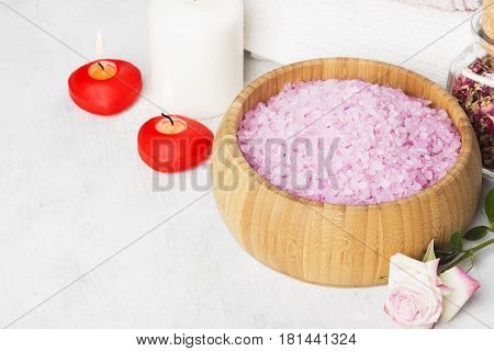 Bath Salt With Aroma Of A Rose In A Wooden Bowl, Petals And A Fresh Pink Rose, Towels And Candles On