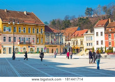 Brasov, Romania - March 24, 2015: Council Square, Piata Sfatului in downtown of Brasov, people near it