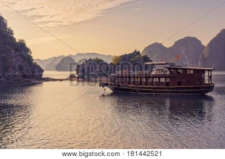 Boat at sunset in Ha long Bay, Vietnam, Southeast Asia