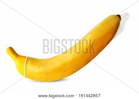 A condom on a yellow banana on a white background. The concept of contraception and safe sex