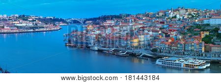 Picturesque panoramic aerial view of Old town of Porto, Ribeira and bridge in the Douro River during morning blue hour, Portugal