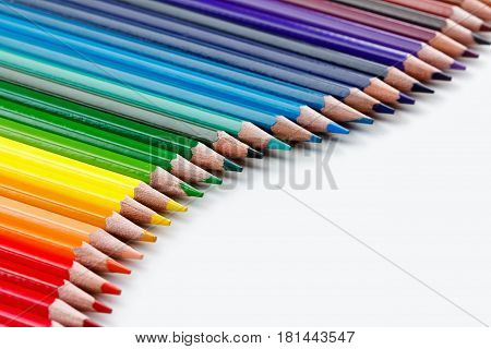 Group of colorful vibrant colored pencils on white background