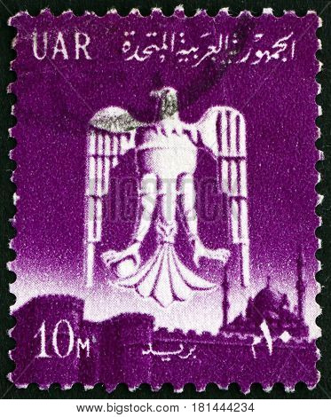 EGYPT - CIRCA 1961: a stamp printed in Egypt shows Eagle of Saladin over Cairo circa 1961