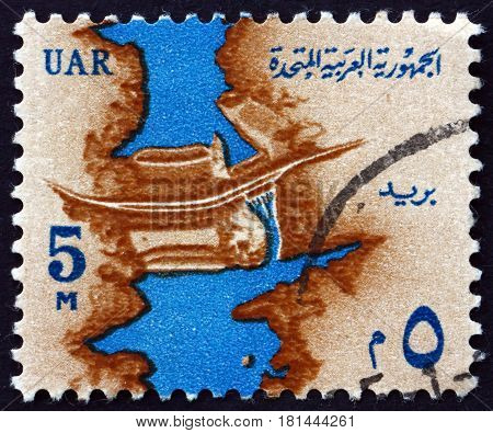 EGYPT - CIRCA 1964: a stamp printed in Egypt shows Nile and Aswan High Dam circa 1964
