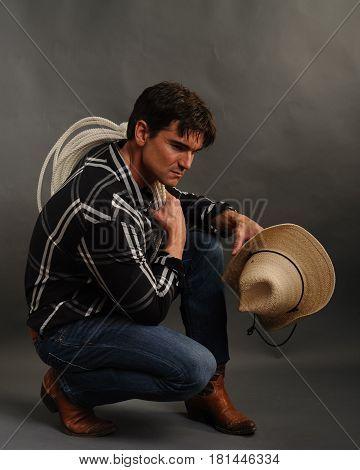 The macho hot cowboy is taking a break.