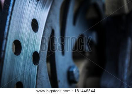 Brake disc. Close-up of car brake disc. Abstract industrial background.