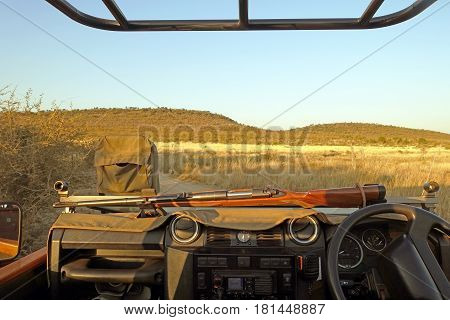Picture of the front af a game drive vehicle with rifle, South Africa.