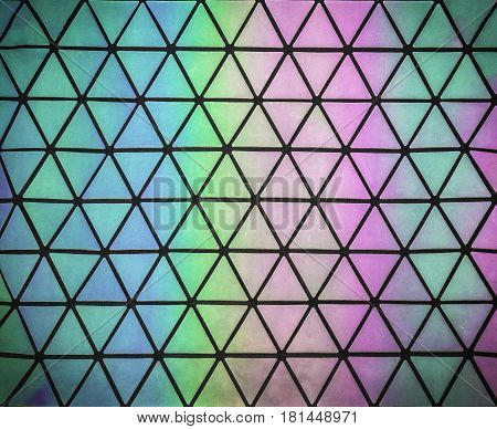 Bright seamless rainbow pattern with iridescent on triangles background